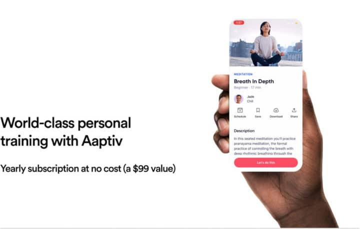 A hand holds up a cell phone with Aaptiv, an audio-based fitness app, on it