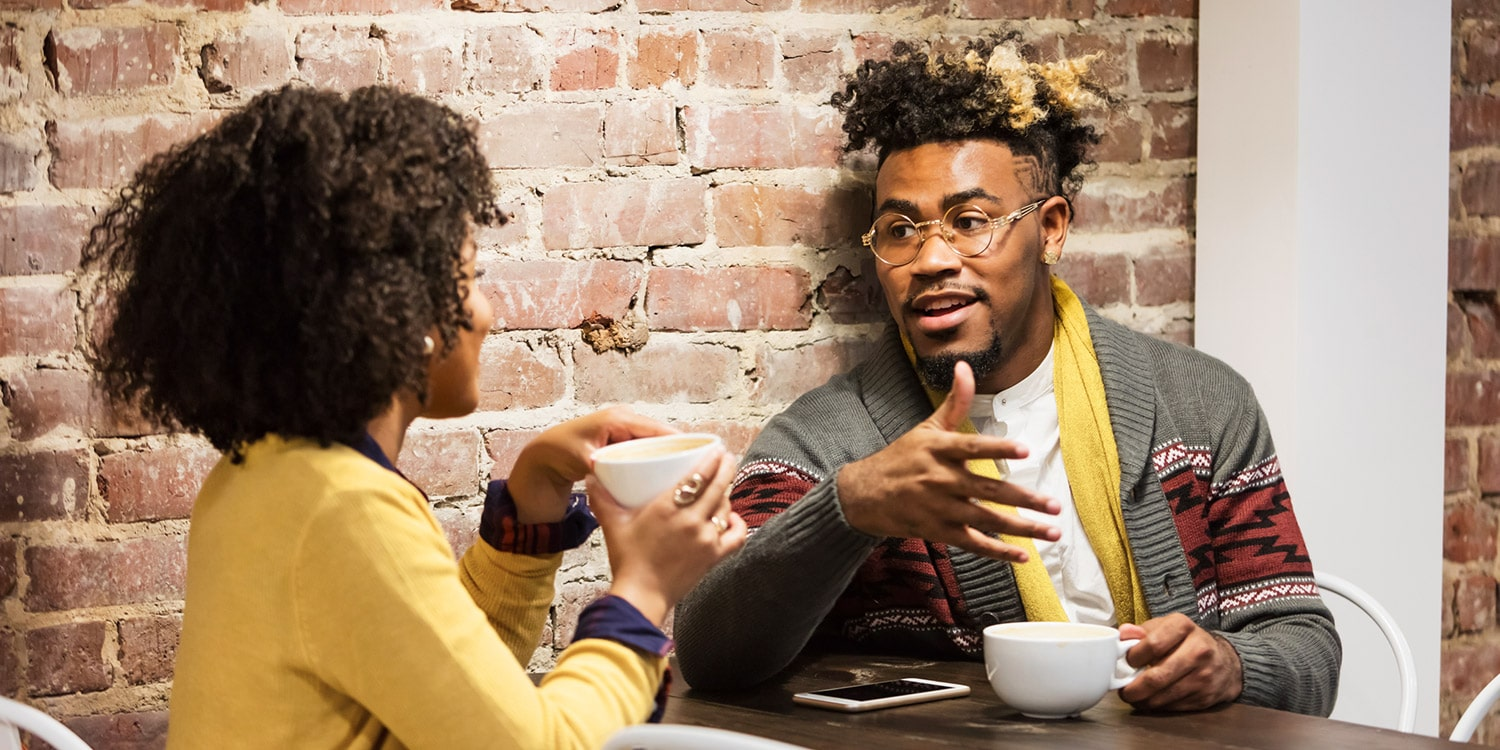 couple discussing finances over coffee