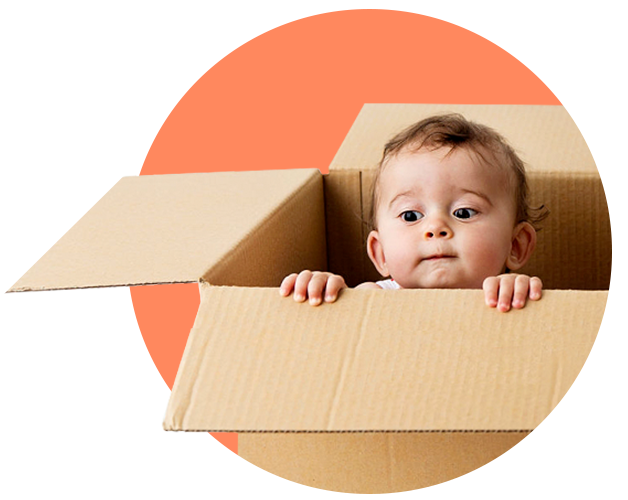 A baby pokes his head out of an open cardboard box.