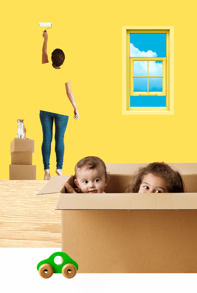 A mother paints the walls of her new house while her two young kids play inside a moving box.