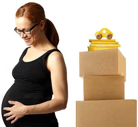 Pregnant woman standing next to a stack of boxes